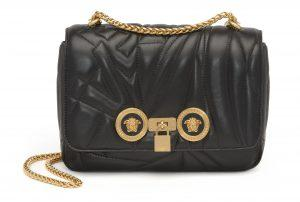 4db703cdd9b61 Stun at a formal event with a gold chain-link Versace's Quilted Logo Icon  Shoulder Bag in finely quilted leather hanging off your shoulder.